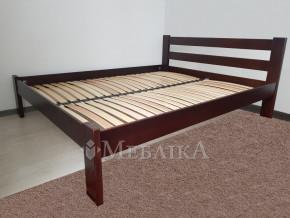 Букове ліжко Соня в мінімалістському оформленні